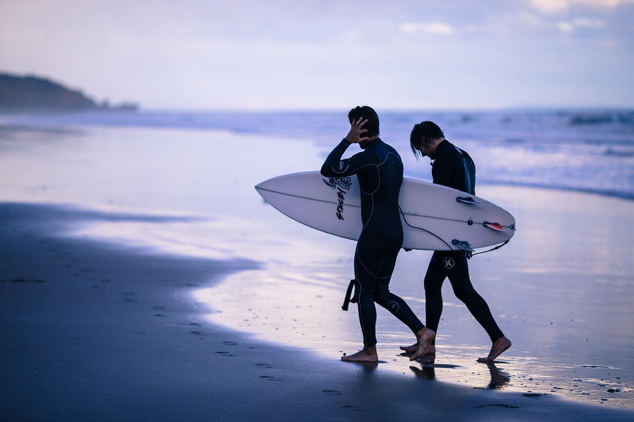 surfers wearing wetsuit at the beach