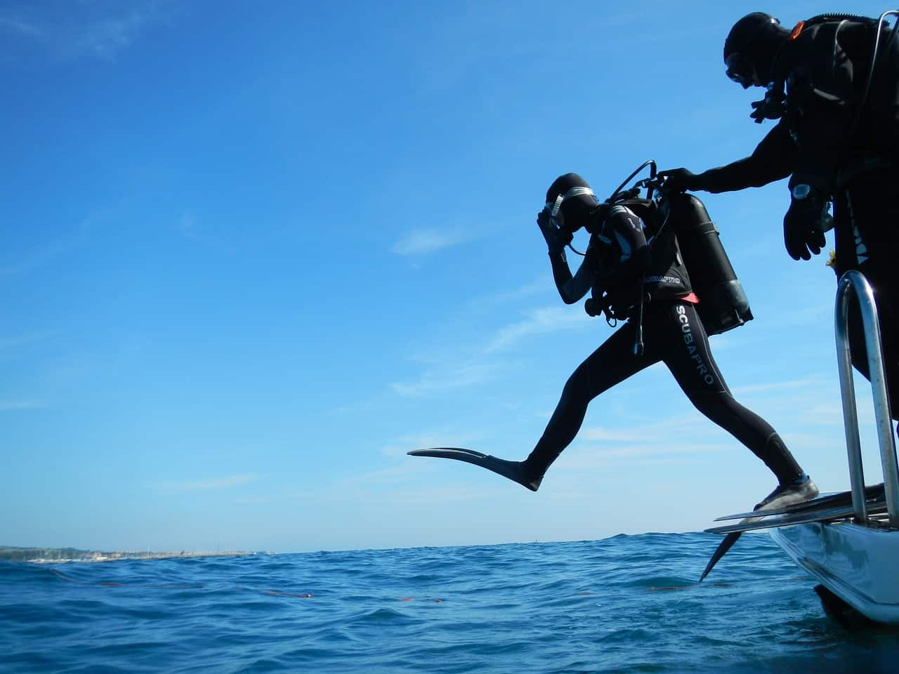Person wearing a diving gear about to dive
