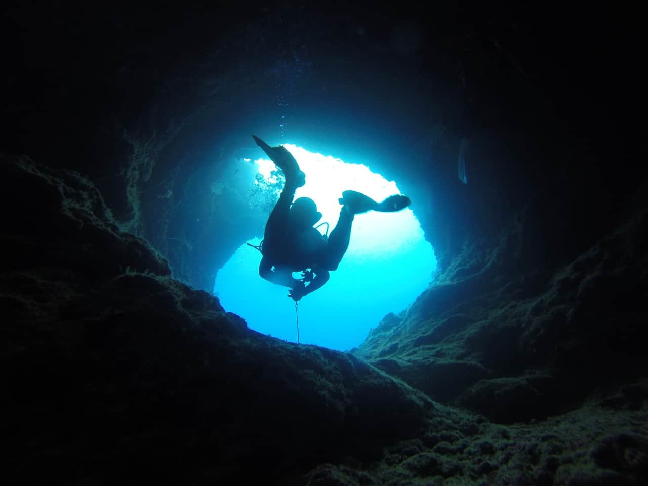 Person swimming on a underwater tunnel
