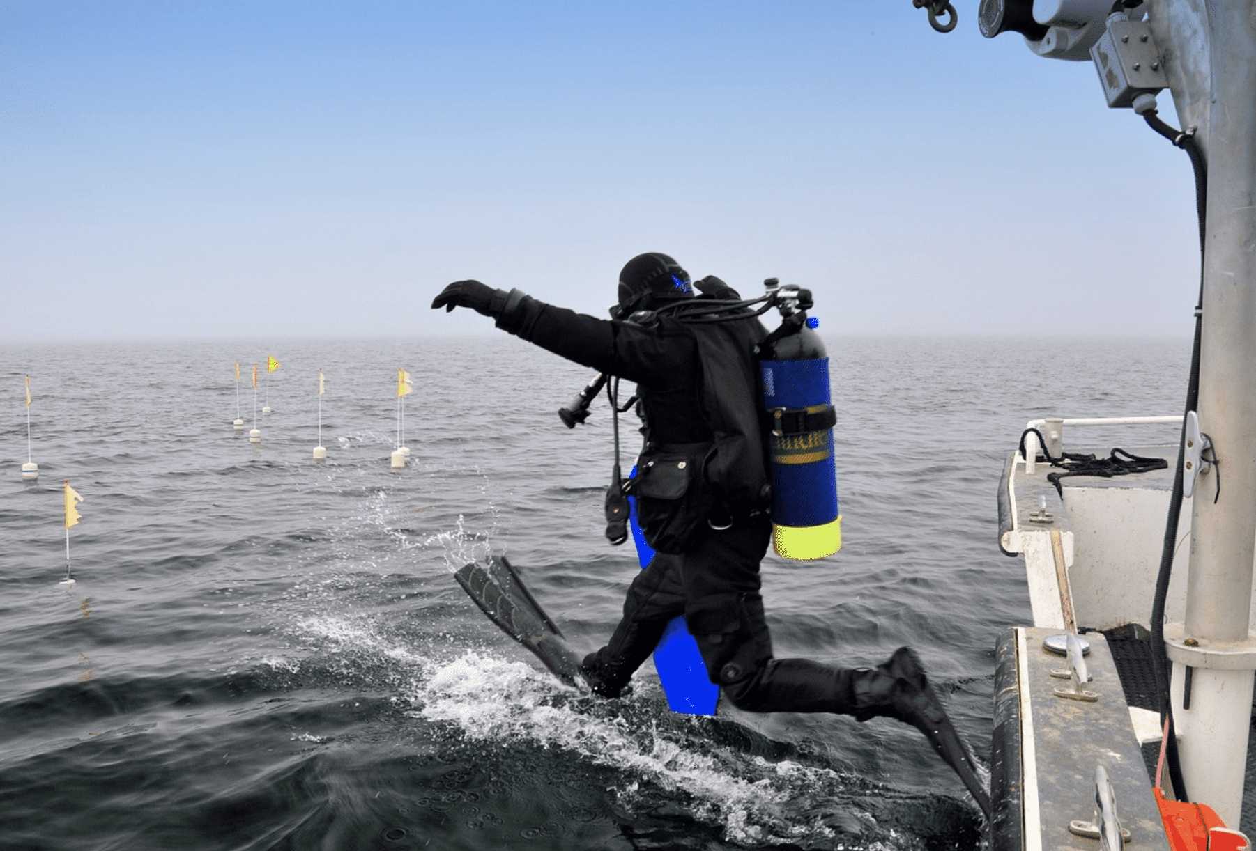 diver about to jump in the ocean