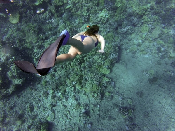 Woman doing freediving at sea