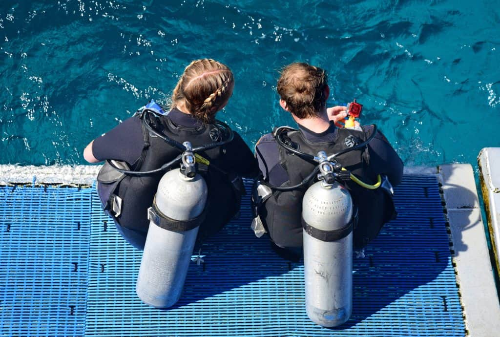 two women preparing to dive into the water